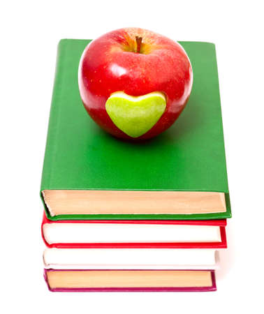 apple with green heart on stack of books photo