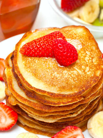 golden buttermilk pancakes with strawberry and banana photo