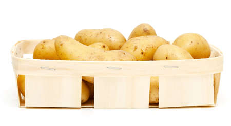 new potatoes in basket isolated on white background photo