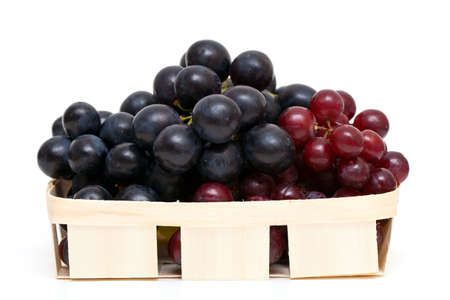 red and blue grapes in a basket photo