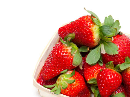 eipe strawberry in a basket isolated on white photo