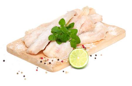 boned: frozen pollock (pallock) on cutting board isolated