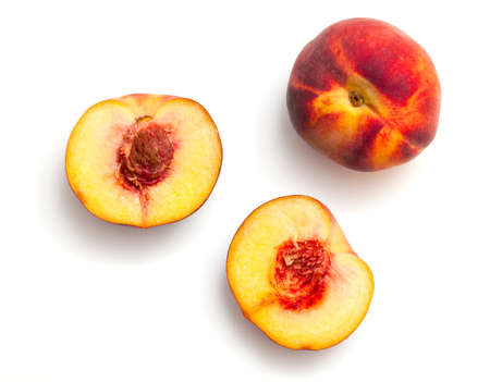 over eating: peach isolated on white background