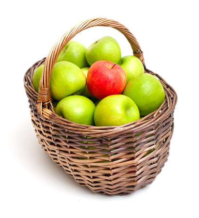 basket with green apples and one red one photo