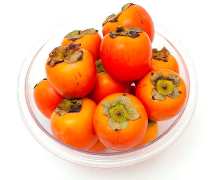 persimmons in a glass bowl Stock Photo - 13936251
