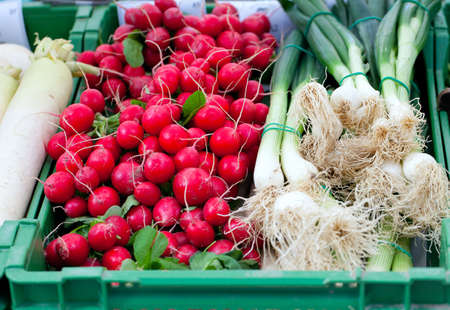 radishes and spring onion on farmers market photo