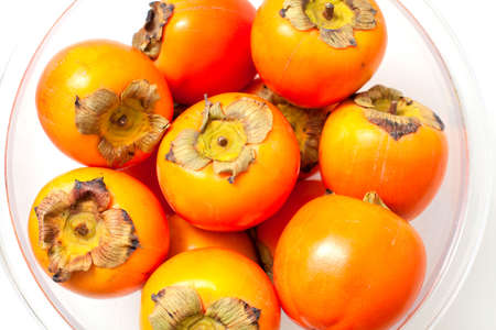ebenaceae: persimmons in a glass bowl