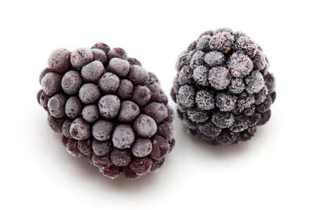 frozen fruit: frozen blackberries isolated on white background Stock Photo