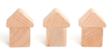 forsale: wooden block houses isolated on white background
