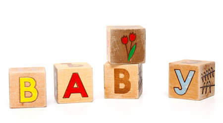 childrens alphabet blocks spelling the word BABY on a white background photo