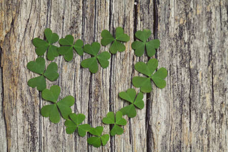st patty day: clover heart on wooden background