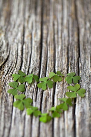 saint paddy's: clover heart on wooden background