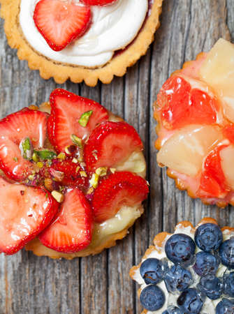 Closeup of fancy gourmet fresh fruit dessert tarts photo