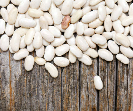 white beans on wooden surface Stock Photo - 14253256