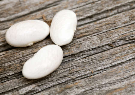 white beans on wooden surface Stock Photo - 14253333