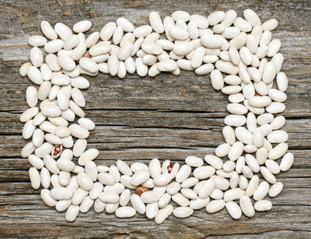 frame made from white beans on wooden surface Stock Photo - 14253399
