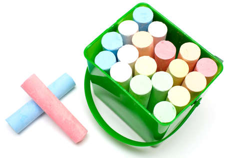 chalks in a variety of colors on a white background photo