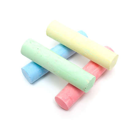 chalks in a variety of colors arranged on a white background photo