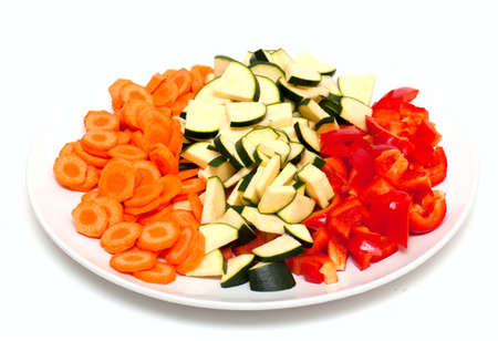 cut vegetables on white plate photo