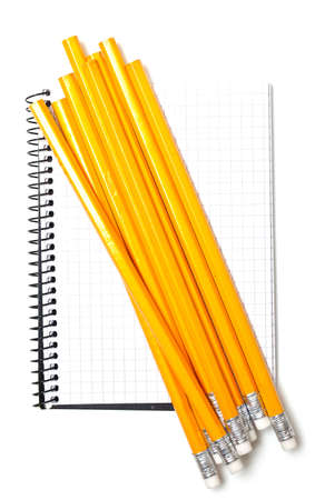 notebook and bunch of pencils isolated on white background photo