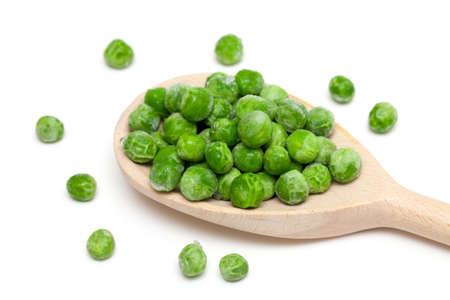 frozen peas isolated on white background photo