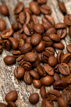 coffee beans on wooden background photo
