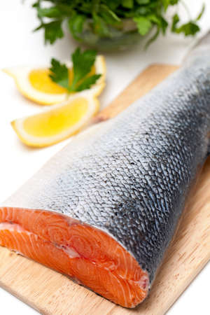 salmon fish: salmon on cutting board Stock Photo