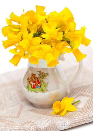 narcissus flowers in vase isolated on white photo