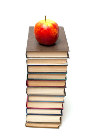 apple on tall stack of books photo