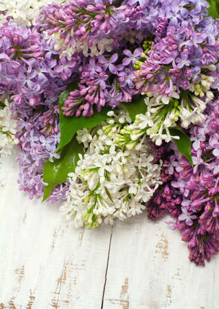 lilac flowers on wooden table photo