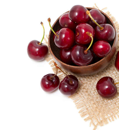 cherry in a bowl on sackcloth photo