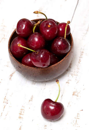 cherry in a bowl on wooden table Stock Photo - 14447112
