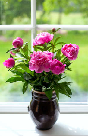 a place of life: vase with peony flowers