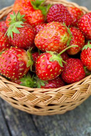 full willow: strawberries in basket on wooden table