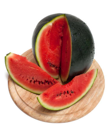 biten: sliced and biten watermelon on a wooden board isolated