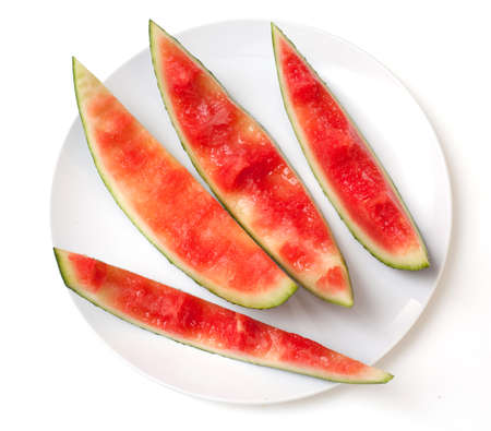 eaten: slices of eaten watermelon on a plate isolated