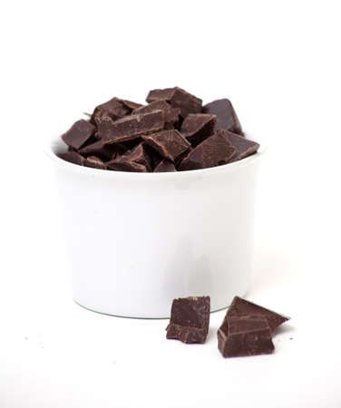 delicious close-up of chocolate in a white dish over white photo