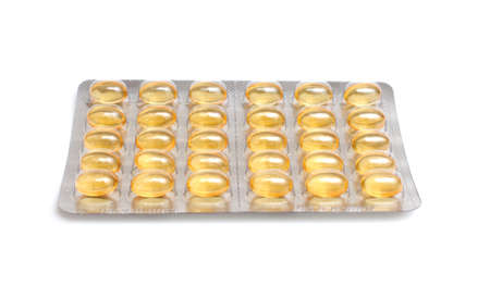 fish oil pills on white background photo