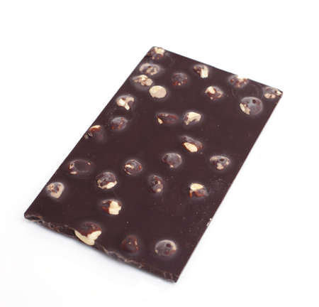 piece of chocolate with hazelnuts on white background