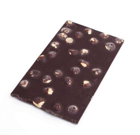cikolata: piece of chocolate with hazelnuts on white background
