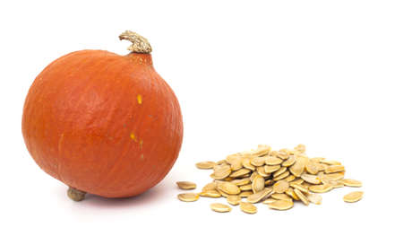 pumpkin and pumpkin seeds on white background photo