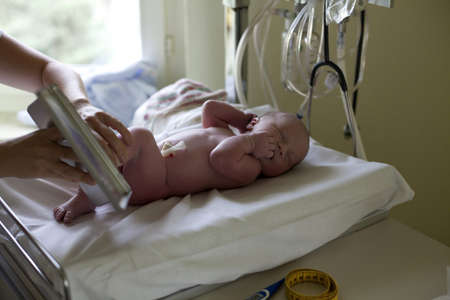 measured: newborn is being measured in hospital Stock Photo