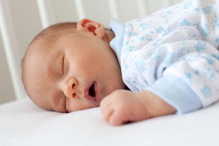 newborn sleeping in a crib Stock Photo