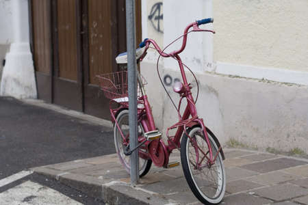 old bicycle on the street photo