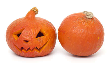 two pumpkins, full and angry one on white background photo