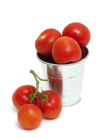 bucket with tomatoes on white background photo