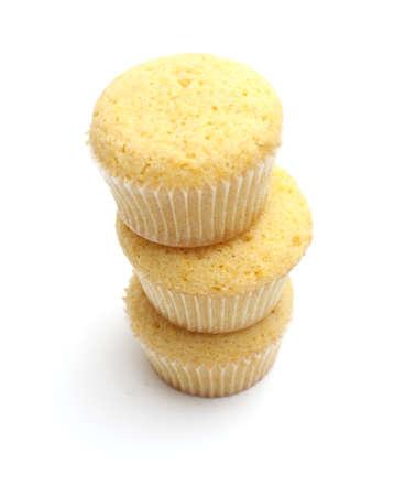 stack of lemon cupcakes isolated on white photo