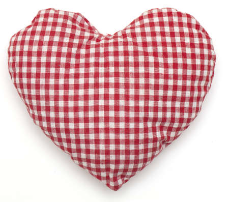 Pillow red and white heart shaped on white photo