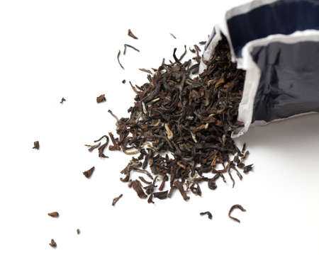 tea falling from tea pack isolated Stock Photo - 14464246