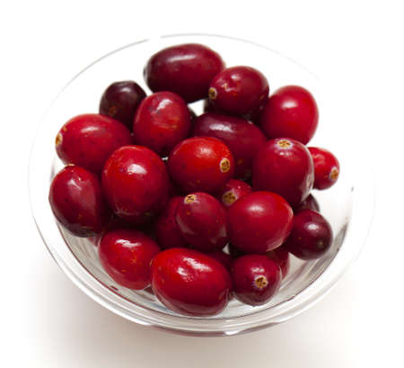 cranberries in a glass bowl isolated over white photo